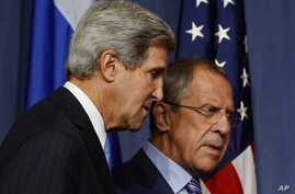 U.S. Secretary of State John Kerry and Russian Foreign Minister Sergey Lavrov, right, arrive for their press conference before their meeting to discuss the ongoing crisis in Syria, in Geneva, Sept. 12, 2013.