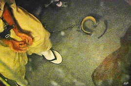 Image from video shows a shackled detainee meeting with medical personnel in Camp 6, at Guantanamo Bay Naval Base, in Cuba, April 16, 2013.