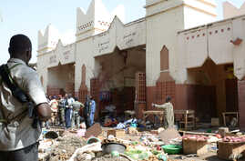 Soldiers and police forces stand guard at a market in N'Djamena, Chad, following a suicide bomb attack, July 11, 2015.