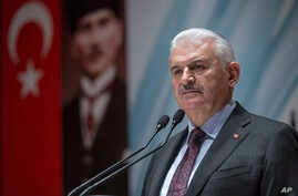 Turkey's Prime Minister Binali Yildirim speak to the country's security chiefs in Ankara, Jan. 18, 2018.