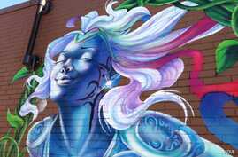 Detail from mural by Aniekan Udofia, Washington, D.C., July, 2014. (J. Taboh/VOA)