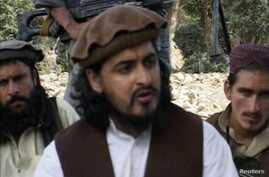 Pakistani Taliban chief Hakimullah Mehsud sits with other millitants, South Waziristan, Oct. 4, 2009.
