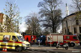 Belgian firefighters stand outside the Grand Mosque in Brussels, Belgium, Nov. 26, 2015, after a powder feared to be Anthrax was found.