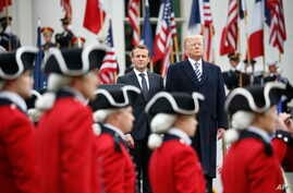 President Donald Trump and French President Emmanuel Macron stand during a State Arrival Ceremony on the South Lawn of the White House in Washington, April 24, 2018.