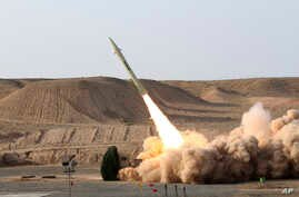 This file photo released on Wednesday, Aug. 25, 2010, by the Iranian Defense Ministry, claims to show the launch of the Fateh-110 short-range surface-to-surface missile by Iranian armed forces, at an undisclosed location.