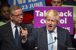 Former London Mayor Boris Johnson speaks as Michael Gove listens at a Vote Leave rally in London, Britain, June 19, 2016.