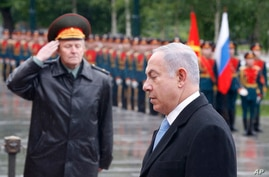 FILE - Israeli Prime Minister Benjamin Netanyahu, right, attends a wreath laying ceremony at the Tomb of Unknown Soldier near the Kremlin wall in Moscow, Tuesday, June 7, 2016.