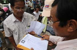 Opposition supporters check and count the thumbprint to submit to petition to King Norodom Sihamoni at Cambodia National Rescue Party's headquarter  on Thursday, 02 June 2016 in Phnom Penh. CNRP is collecting more thumbprints from the supporters to s