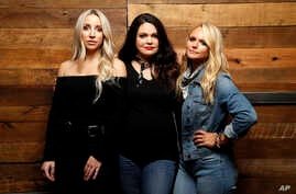 "Ashley Monroe, from left, Angaleena Presley and Miranda Lambert of the Pistol Annies pose for a photo at Sony Nashville in Nashville, Tenn., to promote their newest album, ""Interstate Gospel,"" Oct. 1, 2018."
