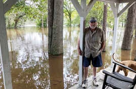 Pastor Willie Lowrimore of The Fellowship With Jesus Ministries talks about the flooding of his church in Yauhannah, S.C., on Sept. 24, 2018. The church is on the bank of the Waccamaw River which has already risen above its record crest.