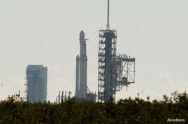 SpaceX's first Falcon Heavy rocket sits on launch pad 39A at Kennedy Space Center, waiting for the first engine test firing it's 27 engines together, in Cape Canaveral, Fla., Jan. 11, 2018.