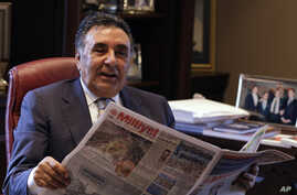 FILE - Turkish media tycoon Aydin Dogan, shown in Feb. 24, 2009, is reportedly about to be indicted on charges of smuggling.