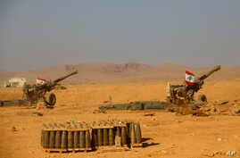 Lebanese national flags are seen set on top of cannons inside a base during a media trip organized by the Lebanese army, on the outskirts of Ras Baalbek, northeast Lebanon, Aug. 28, 2017.