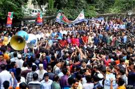 """FILE - BNP leaders and supporters staged a rally in Dhaka on Sept. 10 demanding """"proper"""" medical treatment of former Prime Minister Khaleda Zia, who has been in jail after being sentenced in a case of embezzlement of funds."""