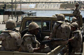 Egypt's army troops cross the Suez Canal to work on an upgrading project to guard Ismailia, a port city northeast of Cairo, Aug. 12, 2014.
