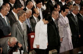 South Korean President Park Geun-hye, center, pays her tribute during a ceremony to celebrate Korean Liberation Day from Japanese colonial rule in 1945, at Seong Cultural Center in Seoul, South Korea, Monday, Aug. 15, 2016.