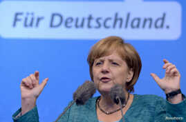 German Chancellor and top candidate of the Christian Democratic Union (CDU) Angela Merkel makes a speech in the northern German town of Sankt Peter-Ording, July 19, 2013.
