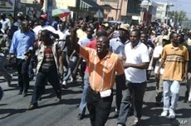 Protesters Demand Haiti's Preval Leave Office Immediately