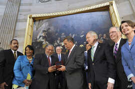 House Speaker John Boehner presents Lonnie Bunch III with a Congressional Gold Medal, June 24, 2014.