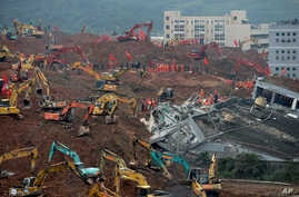 Rescuers using excavators dig the sea of soil to search for potential survivors near the damaged building following a landslide at a industrial park in Shenzhen, in south China's Guangdong province, Tuesday, Dec. 22, 2015.
