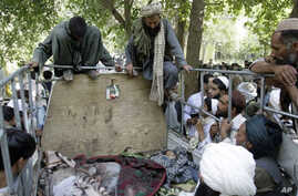 Afghan villagers look at the bodies of two children and a villager after they were allegedly killed in an airstrike by foreign troops in Kandahar, south of Kabul (file)