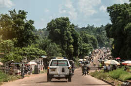 An ambulance carries the remains of an Ebola victim towards a burial site in Mbandaka on May 22, 2018, in the Democratic Republic of Congo.