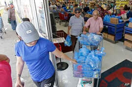 Customers purchase groceries at a local supermarket as they prepare for Hurricane Irma, Sept. 5, 2017, in Hialeah, Fla.