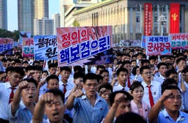 Tens of thousands of North Koreans rally at Kim Il Sung Square carrying placards and propaganda slogans as a show of support for their rejection of the United Nations' latest round of sanctions, in Pyongyang, North Korea, Aug. 9, 2017.