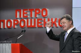 Ukrainian businessman, politician and president-elect Petro Poroshenko gestures to supporters in Kiev May 25, 2014.
