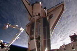 Discovery Docks On Final Trip to Space Station