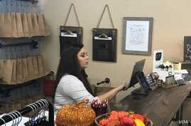 ASK Apparel store owner Alisha Summerville has poor broadband access at home, so to conduct online business she relies on her smartphone and at her brick-and-mortar location in Heber Springs, Arkansas, Oct. 12, 2018.