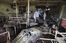 People inspect damaged cafe following suicide bombing, Balad, 80 kilometers north of Baghdad, Aug. 13, 2013.