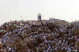 Muslim pilgrims gather on Mount Mercy on the plains of Arafat during the annual haj pilgrimage, outside the holy city of Mecca, Saudi Arabia, Sept. 11, 2016.