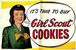 A vintage banner advertises Girl Scout cookies. (Courtesy / Girl Scouts of the United States of America)