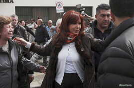 Argentina's President Cristina Fernandez de Kirchner greets supporters outside a polling station in Rio Gallegos, Argentina, Oct. 25, 2015.