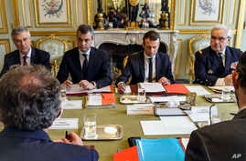 French President Emmanuel Macron, center right, chairs a security council meeting at the Elysee Palace in Paris, 18 May 2017.