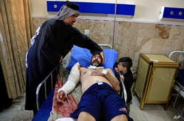 A victim of a bombing attack receives treatment at the Imam Ali Hospital in Sadr City, Baghdad, Iraq, Feb. 29, 2016.