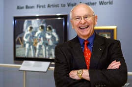 FILE - Alan Bean, the fourth man to walk on the moon, is shown during a preview of his work at the Lyndon Baines Johnson Library and Museum in Austin, Texas, Oct. 1, 2008.  Bean, the Apollo and Skylab astronaut, the fourth human to walk on the moon a