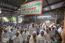 "Members of Ethiopia's Jewish community gather below a banner reading ""Welcome"" in Amharic, English and Hebrew, to protest the Israeli decision not to allow all of them to emigrate to Israel, leaving their families divided between the two countries, i"
