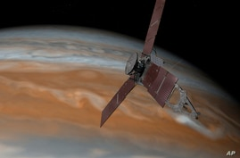This artist's rendering made available by NASA/JPL-Caltech on July 7, 2015, shows the Juno spacecraft above Jupiter.