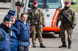 Belgian police men and soldiers secure the area outside Zaventem Airport in Brussels, March 29, 2016.