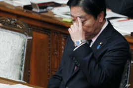 Japan Downgrades Economic Forecast