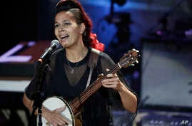 FILE - Rhiannon Giddens performs during the Americana Honors and Awards show in Nashville, Tennessee, Sept. 13, 2017.