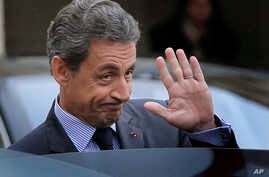 "FILE - Nicolas Sarkozy, former French president and head of the conservative ""Les Republicains"" party, is seen leaving after a meeting with French President Francois Hollande at the Elysee Palace, in Paris, Jan. 22, 2016."