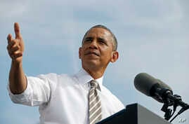 President Barack Obama speaks about the government shutdown and debt ceiling during a visit to to M. Luis Construction in Rockville, Maryland, Oct. 3, 2013.