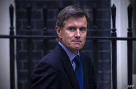 FILE - John Sawers, then chief of Britain's foreign intelligence service MI6, arrives at Downing Street ahead of a meeting of the National Security Council, in central London, Aug. 28, 2013.
