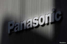 FILE -  Panasonic's logo is seen on a wall of an electronic shop in Tokyo, Japan.