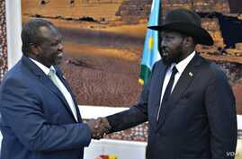 South Sudan rebel leader Riek Machar,left, shakes hands with Salva Kiir. Machar is the leader of the Sudan People's Liberation Movement In Opposition. Kiir is leader of the Sudan People's Liberation Movement.