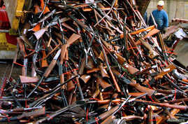 FILE -  A truck unloads prohibited firearms at a scrap-metal yard that have been handed in over the past month under the Australian government's buy-back scheme in Sydney, Australia, July 29, 2017.