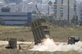 """A missile is launched by an """"Iron Dome"""" battery, a short-range missile defence system designed to intercept and destroy incoming short-range rockets and artillery shells, on July 11, 2014 in the southern Israeli city of Ashdod. Three Gaza rockets wer"""